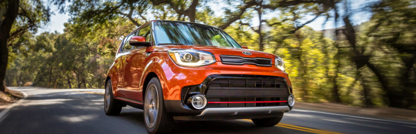 2019 Kia Soul Driving Down The Road During Foliage