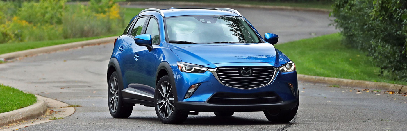 Mazda CX-3 Blue sitting in road wheel turned