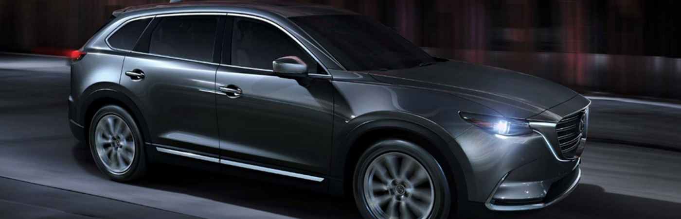 Mazda CX-9 driving down the road with led lighting