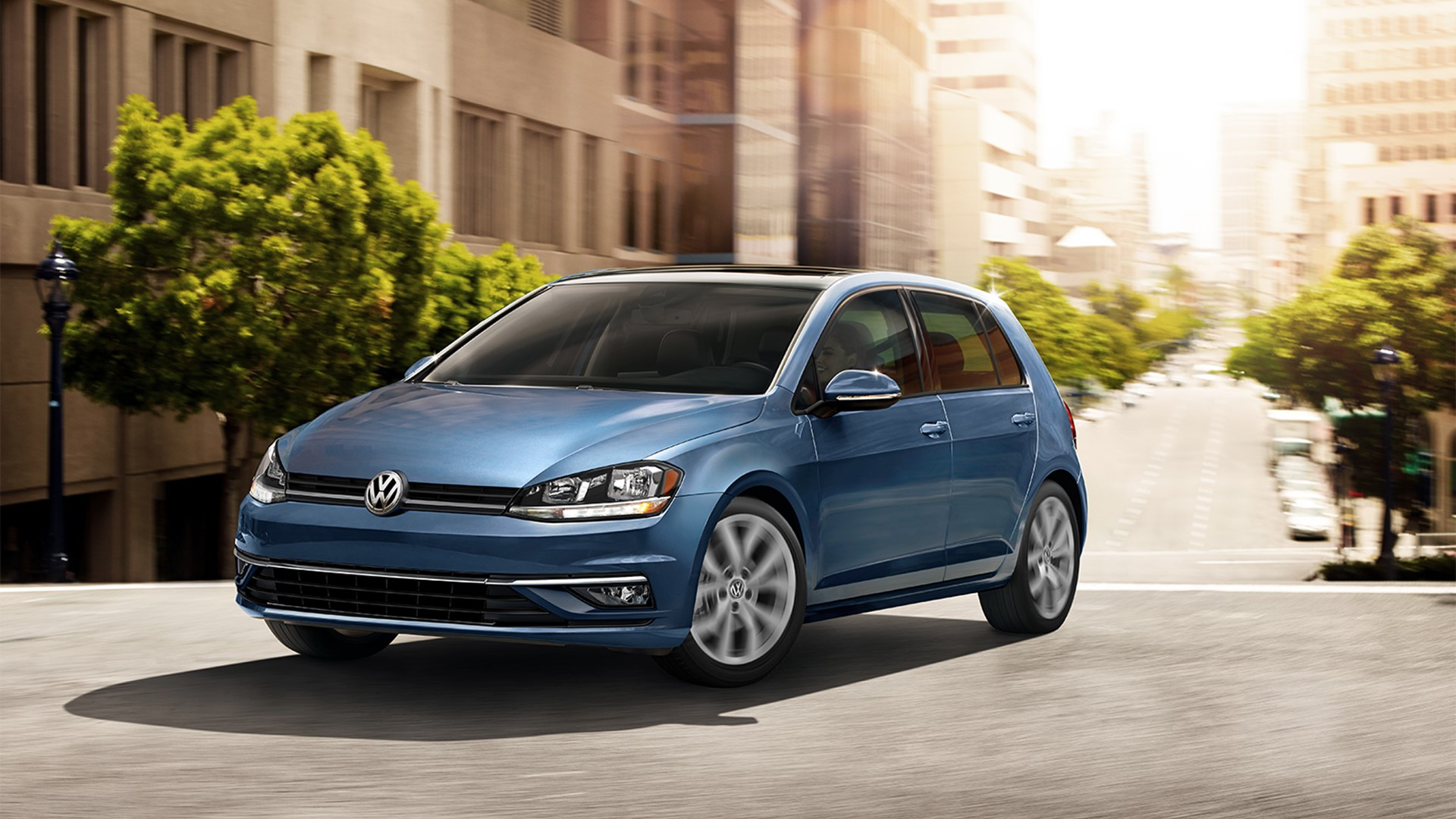 Blue Volkswagen Golf Driving in the City