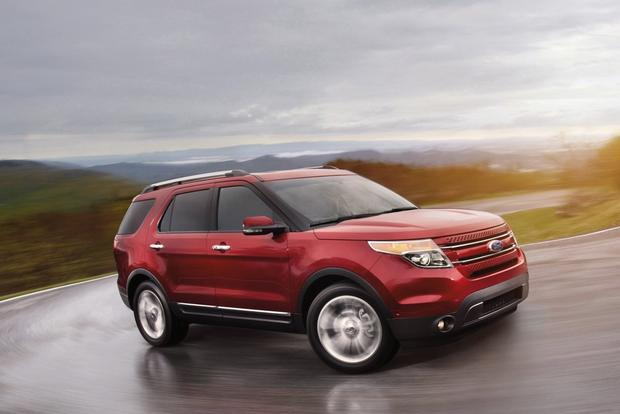 Ford Explorer Driving Up Mountain Road