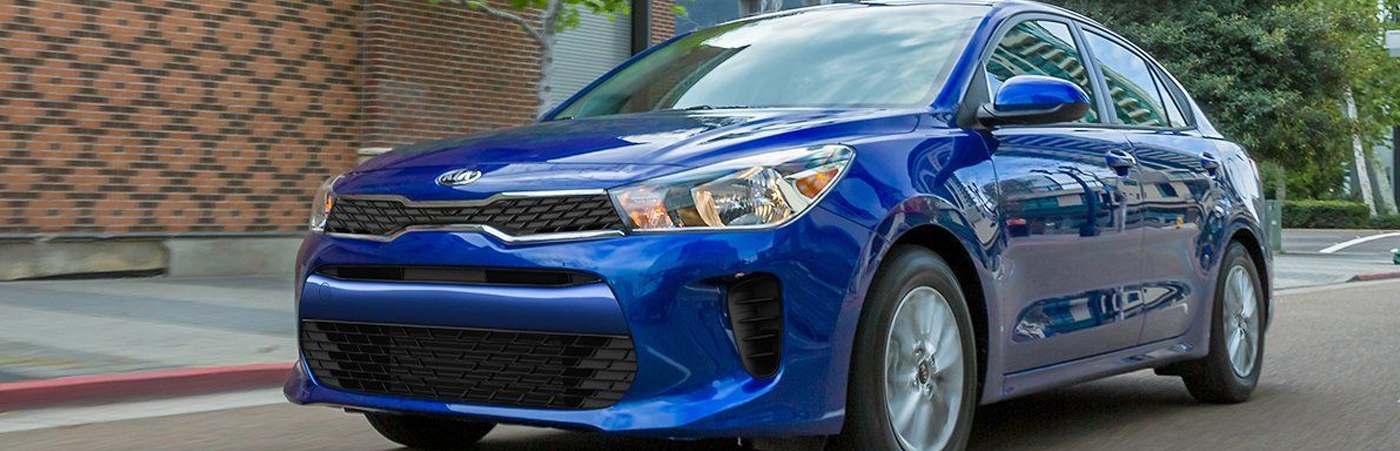 Kia rio Driving With Blue Paint
