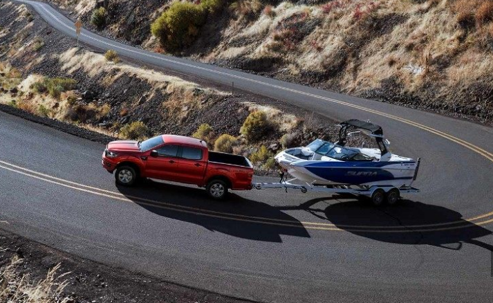 2019 Ford Ranger towing boat up hill