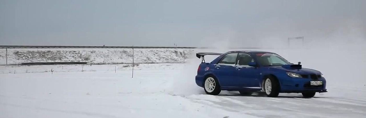 Blue Subaru Drifting in Snow
