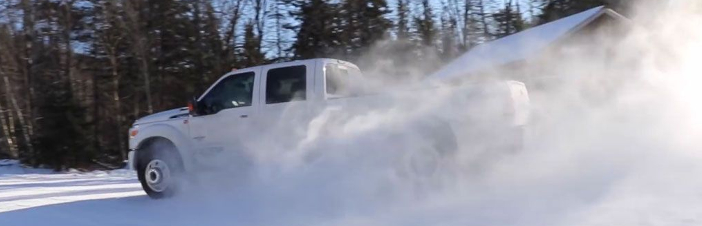 White Ford Drifting in the Snow