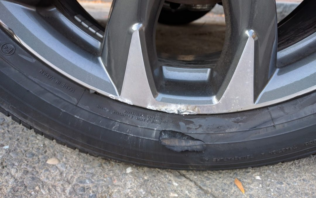 Car Wheel with Curb Damage